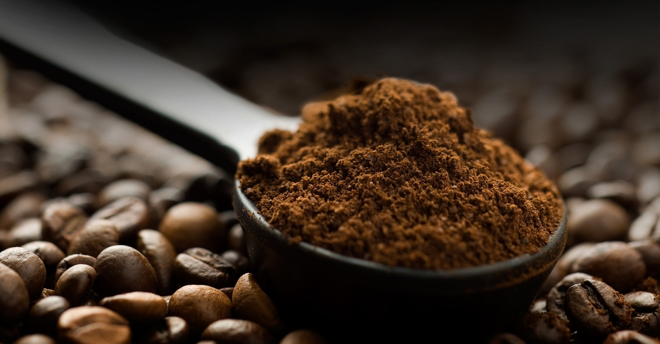 Coffee beans and ground with spoon